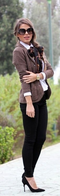 Tweed jacket over white blouse and black jeans.