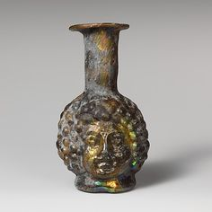 Glass double head-shaped bottle 3rd century A.D. Roman, Syrian