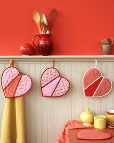 Heart-Shaped Pot Holders | Martha Stewart..these have little sleeves on each side to put your fingers in... free pattern and instructions!!
