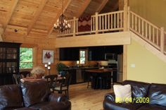 Log Cabin Great Room, Interior of our recently built log cabin., Rustic log cabin living area looking towards the kitchen and log., Living R...
