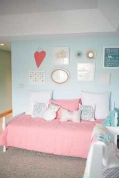 Aqua and Coral Nursery - love the gallery wall over the day bed!