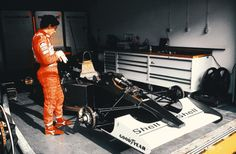 An impatient @ayrtonsenna checks his watch in the @McLarenF1 pit