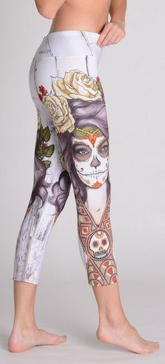 "$46.99 - CAPRI SUGAR SKULL PRINTED, DAY OF THE DEAD WORKOUT LEGGINGS FOR WOMEN. Take the passion of Mexico to your next yoga / gym sweat sesh with this intricately decorated pair of sugar skull capri leggings. Illustrated on both sides is La Calavera Catrina, their beloved ""Dame Of Death"" - usually depicted in a skeletal form, these leggings portray her with a deathly  pale face adorned with luscious red roses. Also notice the stunning 'sugar skull' etching on her face."