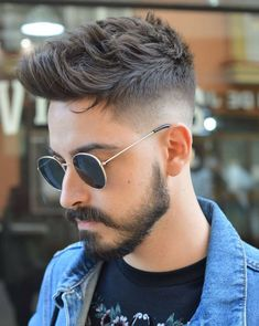 Our experts picked the best comb over fade haircut styles currently trending. From a low fade comb over to a high fade comb over, these comb over haircut styles are hot. Comb Over Fade Haircut, Fade Haircut Styles, Beard Styles, Mid Fade Undercut, Disconnected Undercut, Undercut Pompadour, Men Undercut, Undercut Hairstyles, Protective Hairstyles
