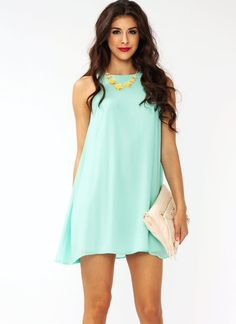 Not only will this sleeveless, fully lined shift dress hide a food baby, but it will make you look totally pretty and flirty.