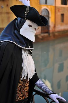 Bauta mask, photo by Alain Boussac. ong considered the traditional and archetypal Venetian mask, the Bauta always used to appear in white, and even though it was worn extensively throughout the Carnival period it owes much of its prominence to the fact that it was used all year round by those simply wishing to hide their identity. It was also a comparatively practical mask, since, lacking a mouth and covering only the upper half of the face, it enabled masqueraders to eat and talk more…