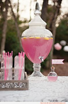 """Girly Beer"" - 6 pack of light Beers, 1 can frozen Pink Lemonade concentrate, and Vodka. Fill your punch bowl or drink jar with ice, pour in the beers, add the lemonade concentrate and stir (TIP: Leave your lemonade sitting out for a bit before mixing up this drink, if its a little defrosted, it will stir in easier). Fill the empty lemonade can with vodka, stir in and enjoy!"