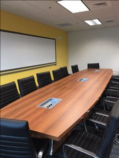 Boat Shaped Conference Table with powered Grommets and Leather Conference Chairs. http://joycecontract.com/conference-room-tables/
