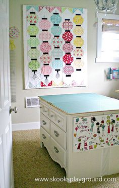 "Skooks of ""Skooks Playground"" took an old dresser and matching desk, put them back-to-back and created an extra large cutting table and storage space in her studio.  Love this!  <3"