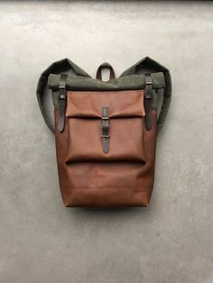 The material I used to make this bag is an American heavy weight waxed canvas. The color is olive, I added hazelnut colour oiled leather over a...