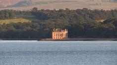 Barnbougle Castle on the Dalmeny Estate seen across the river from Dalgety Bay.