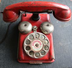 Toy metal telephone.  When you turned the dial the bell would jingle.