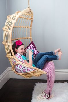 rattan hanging chair for reading corner // girls bedroom, looks comfy. Would love to do this for B when she's older & has a bigger room