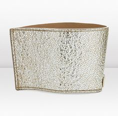 RIKA BY JIMMY CHOO    Add a touch of style to your morning coffee break with RIKA, a luxurious glitter leather cup holder.
