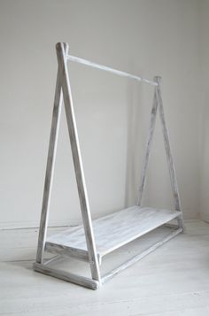 Clothes Rack !    Dimensions: Height : 125 cm from the floor to the highest point of the rail, Length: 120 cm Width: 45 cm Shelf 17 cm from the floor.  Hand Made.  Unpainted, untreated, pure natural wood.  It is quick and easy to assemble   When not in use you can quickly disassemble into pieces and stored away!   Instant and modern solution to any lack of clothes storage   Can be created to different dimensions if asked for.  Not for climbing purposes. Only for decoration.   We do not have…