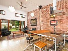 exposed brick walls + fans + louvre windows + raked ceiling + high windows