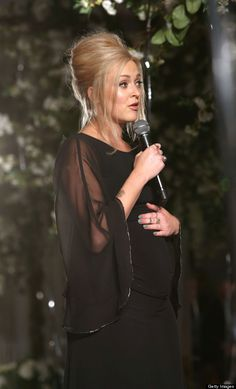 Fearne Cotton rocks a glam black dress and a cute bump at the launch of the new Very range