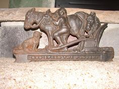 "Antique"" God Speed the Plough"" Rdwardian cast iron door stop"