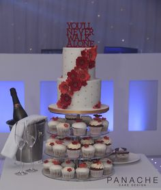 cutting cake cupcakes tiered cakes wedding cake London engagement personalised red orange sugar flowers quilted design cake stand