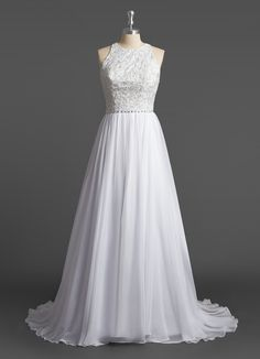 The Azazie Lilliana is a modern Bridal Gown that features a round neckline, lace detailing on the bodice, an empire waist with rhinestone detailing, and a floor-length pleated skirt. This flattering silhouette can be dressed up or down and looks gorgeous with a long veil. Seen here in White.
