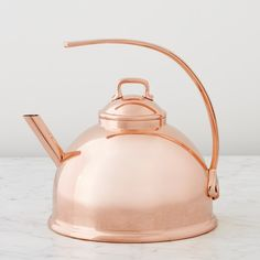 Mauviel Teakettle, Copper | As practical as they are beautiful, these sleek, sculptural teakettles boil water in a flash. Available in stainless steel or copper-plated steel finishes, each has a flat base for fast, even heating. The gracefully arched handle stays cool to ensure a safe, comfortable grip. | $200