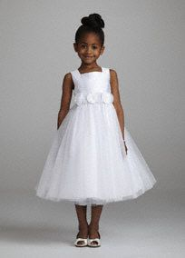 On sale for $59! Your flower girl is sure to feel like a mini princess on your special day!  Tea length glitter tulle ballgown with detachable 3D floral sash.  Available in White. Sizes 2T-14.   Also available in infant sizes- 12M, 18M, and 24M.  Fully lined. Button back closure. Imported polyester. Dry clean only.