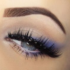 Heavily lined with soft blue eyeshadow that goes with every thing dark blue