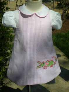 Pink seersucker girls aline jumper with lilly alligator applique ready to ship size 18 mos. $45.00, via Etsy.