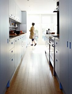 Long counter run, ice blue cabinets, bamboo floor, solid oak countertops   Remodelista
