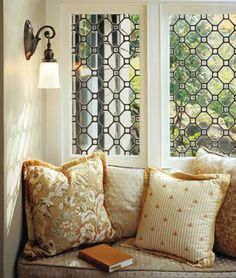 Reading nook. I like the lighting and the window details. Resources used may have been Rejuvenation Hardware.