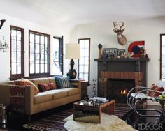 Designer Steven Johanknecht's LA tudor cottage. As shown in Elle Decor, April 12. I think the furry rug was the first thing to catch my eye. The space has a bit of a mid-century feel, but also incorporates warm navajo-esq pillows and rugs.