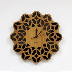Retro Sunburst Wall Clock  60s Floral Black by HOMELOO on Etsy.  Made of bamboo and acrylic.  Coated with Germany beeswax.