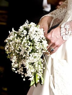 BOUQUET  Symbolism was key in the small bouquet Catherine carried, designed for her by Shane Connolly. In addition to the flower sweet William, the bouquet included lily-of-the-valley (for return of happiness), hyacinth (constancy of love) and ivy (for fidelity, marriage and affection). Also key to the arrangement were stems from plants grown from sprigs of the bridal bouquets of Queen Victoria and Queen Elizabeth.