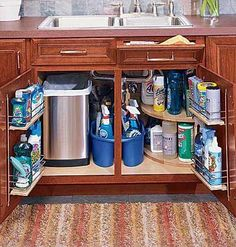 "Under the Sink:  ""The space under the kitchen sink is a challenge. So many plumbing parts are in the way that it often becomes a dark cave. Look to tilting drawers, door racks, stacking shelves, and plastic buckets filled with cleaning supplies to bring order to your cabinet."""