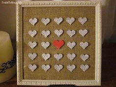 a burlap-covered cork board with a pretty frame around it can make a great seating card display!