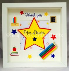 Lovely 'thank you teacher' box frame. The design and wording has been cut from a mixture of card stock adhesive vinyl and has been topped with a number of embellishments.  This frame makes a lovely keep sake gift for that special teacher The frame measures approx 25.5cm x 25.5cm and is 4.5cm deep. Please list the teacher's name in the personalisation box when placing your order.