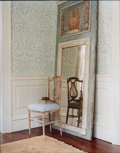 Big beautiful trumeau mirror, wall paneling and simple patterned wallpaper   (Fiona Newell Weeks)