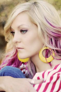 Call me crazy but I sort of want purple streaks in my hair like this...FUN!  And just temporarily ;)