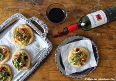 mini pizzas with prosciutto, brie, pear and dry cranberries