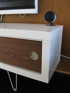 """I'm loving what Jeff in LA did with the Lack shelving unit. The sliding doors and hairpin legs are just perfect. He says, """"After discovering your site and seeing some of the other lack media cabinet hacks, I thought I'd send some photos of my own. Yeah, I know, I need to do something to [&hellip"""
