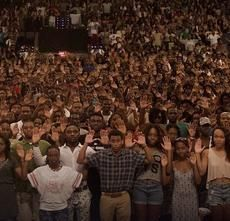 Howard University Students raising hands in