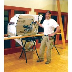 """FastCap ChopShop Saw Hood Heavy-duty water-resistant nylon hood creates a shell around chop saws, miter saws, lathes etc. Collapsible frame. Hood dimensions are 42""""W x 30""""D x 31""""H. Includes mounting hardware, but no shop vac or dust collection hookup. Just empties into a box. 48 customer reviews on Amazon."""