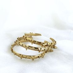 The Star Bangle brings the perfect golden flash to any outfit. This piece is gold-plated, studded with stars and adorned with subtle sparkle from. Cuffs, Bangles, Wedding Rings, Engagement Rings, Stars, Gold, Jewelry, Bangle Bracelets, Jewellery Making