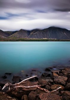 Borgarnes, Iceland. Steeped in Icelandic saga history and excellent Reyka vodka, this town of about 2,000 has a surrounding fjord where clouds surreally stream out from between clefts only to vanish.