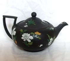 A circa 1867 Wedgwood Black Basalt Hand Painted in Polychrome Enamels and Gilded Famille Rose Large Egyptian Shape Teapot    at ebay.  le sigh.