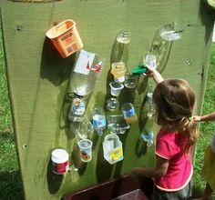 Fun project for Earth Day from let the children play- recycle your plastic containers into a water wall