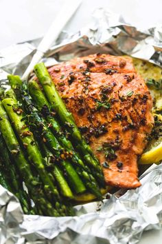 Easy, healthy, garlic herb butter salmon and asparagus foil packs are a quick and tasty 30 minute meal for summer nights, camping, and cookouts.