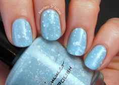 KBShimmer Winter 2014 Collection (Partial)  KBShimmer Snow Way! This snow inspired polish features a pale, sky blue crelly base with white glitters while micro sparkles glisten like fallen snow on a clear winters day. I'm showing three coats below with top coat.