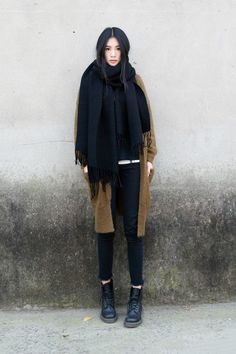 Total black, cloth coat and skinny pants.