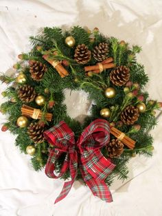 Boutique Blooms Floral Design - traditional cinammon and pine cone Christmas door wreath, decoration.